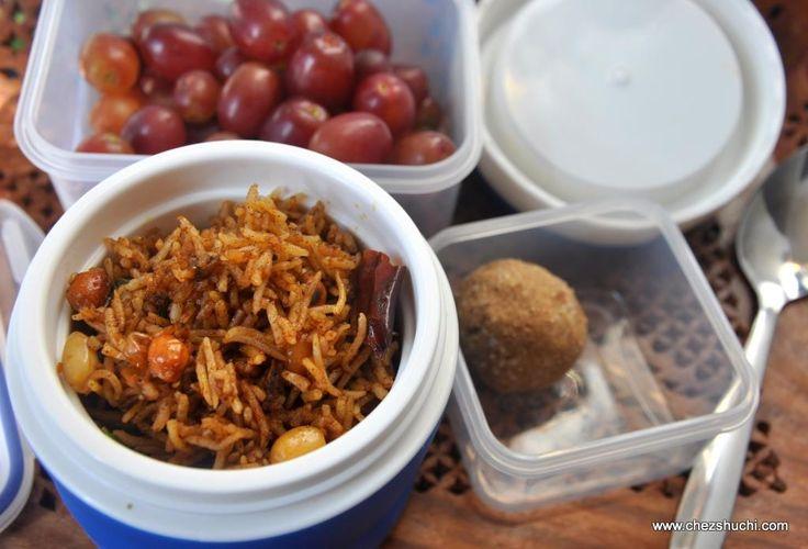 Lunch Box idea- tamarind rice with grapes and laddu बच्चों के लंच बॉक्स के लिए बनायें इमली के चावल!  http://chezshuchi.com/Tamarind_Riceh.html