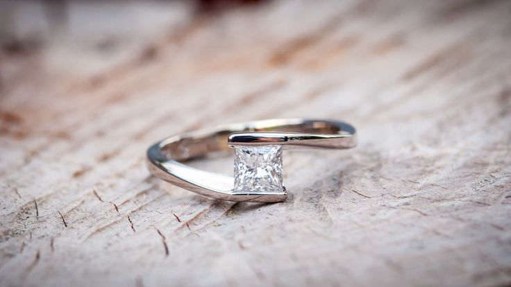 So many facets, so much sparkle from this princess cut diamond, 18ct white gold engagement ring. Dreams are made of this. By The Rolling Mill, Wellington, New Zealand.