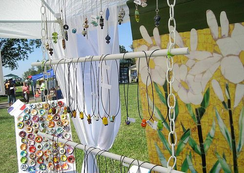 Jewelry display on hanging objects. Great for a tent market situation!  #Jewellery #necklace #colour