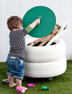 Old tires repurposed into outdoor storage bin