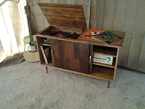 Retro Record Player Console. Beautiful record console with flip lid for record player and space for records and hi fi equipment. *spring loaded hinge. *full skirt *vertical grain fir sliding doors.