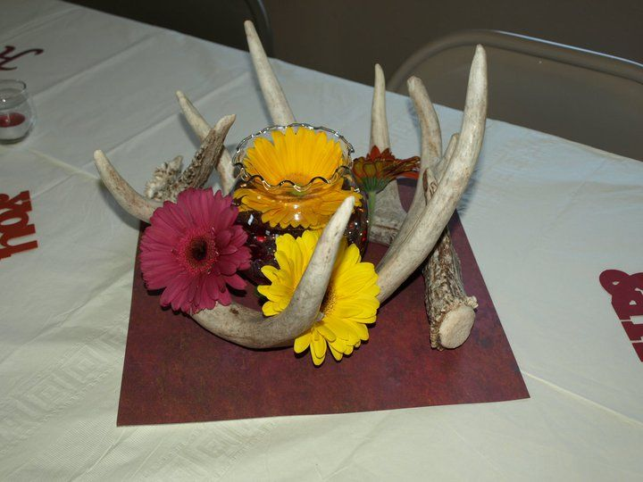 cute with the sheds...but maybe not those colors.....  camo wedding centerpiece from my aunts wedding