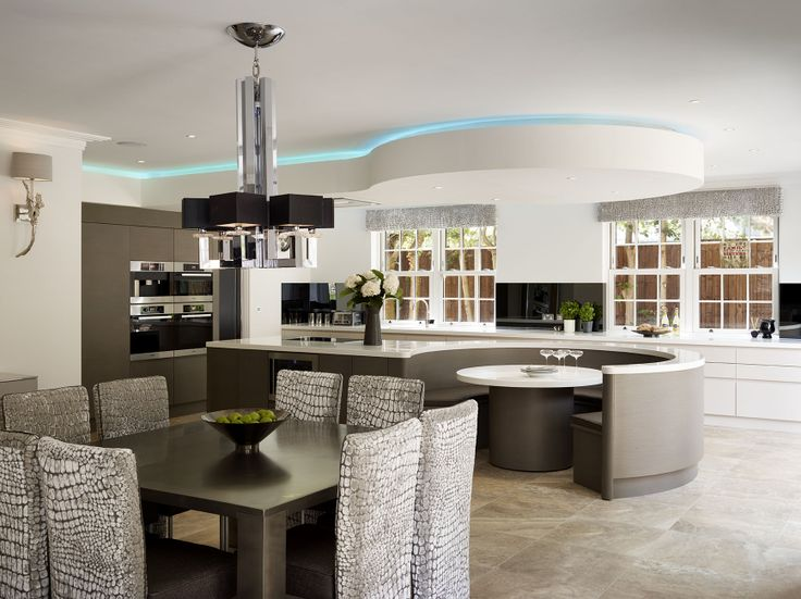 An impressive contemporary bespoke kitchen design from Esher Surrey with wow factor in the design. This called for some pretty radical thinking outside the box! #bespoke #radical #softfurnishings #CharlesYorke #Banquet #Seating #Bulkhead #JonesBritain #Kitchen #KitchenDesign #Heathfield #EastSussex #Sussex #Surrey