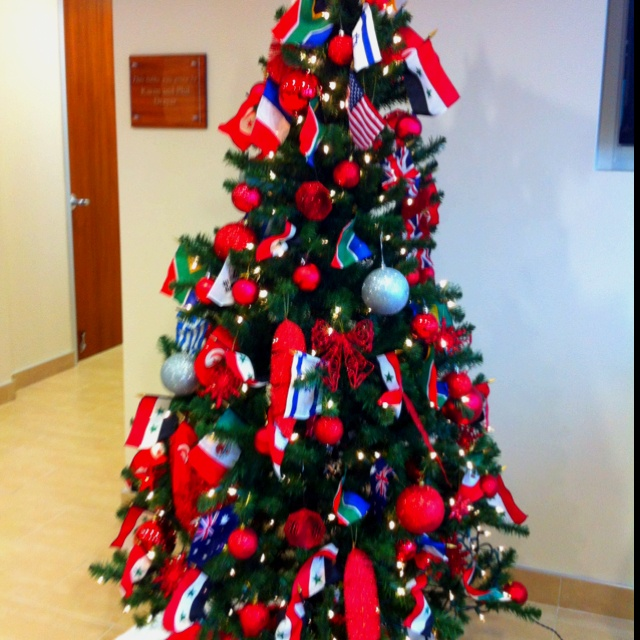 International Christmas Tree- Decorated With Flags From
