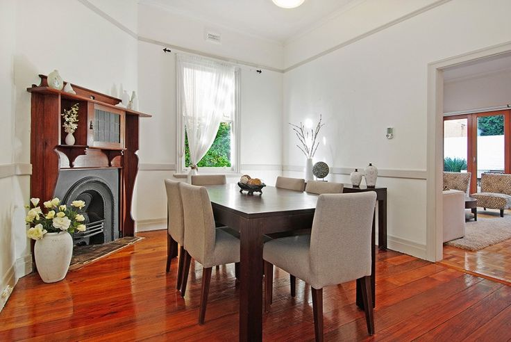 Classic and stylish dining room with featured fireplace. A great pick for your design ideas.