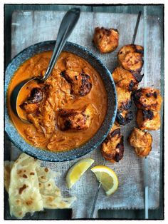 Madhur's Chicken Tikka Masala from Madhur Jarffrey's Curry Nation cookbook. Serve with Indian breads or rice. A black dal would go well with such a meal. I prefer chicken thighs but you may use breasts if you wish.
