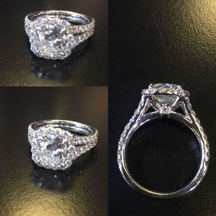 Wow!! A glamorous engagement ring, cushion halo with round brilliant cut center stone with split shank and peek a boo diamond on each side