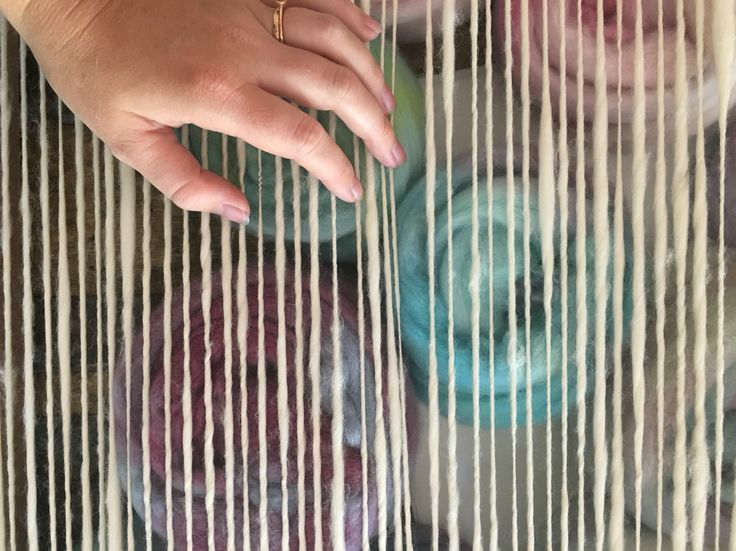 Using my hand spun as a warp. Hand dyed fibre underneath ready to be spun up