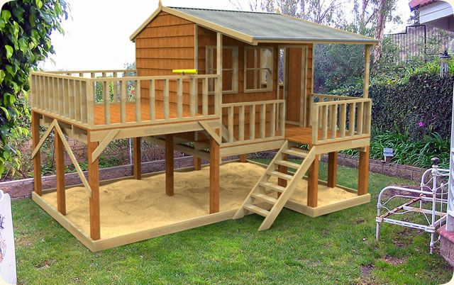Love this. I would swap out the sand for outdoor play mats. Maybe raise a bit higher for a kid's picnic table and water tables. Storage for their bikes, etc.