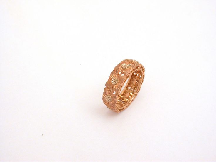 Ring - Shamrocks - Two Colors. 18 carat gold (kt), pink and white gold, 6.00 grams (gr). Size: 7 inches (Usa)   14 mm (Italy).Codex: ELA.ss.