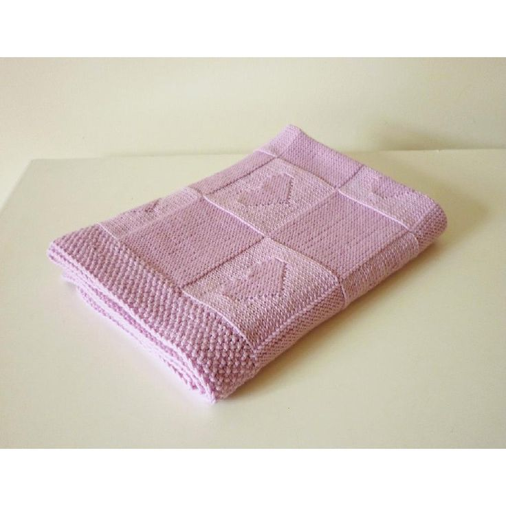 """Lovely baby blanket """"Charlotte"""" pattern with little hearts. This blanket is reversible as it is knitted in knit and in purl stitches.Made by you and with love - it will be a perfect gift to your friends' baby!♥ This pattern is written in standard US terms (in English)♥ This blanket is knitted from 100 % Merino wool ( Drops Design, Merino Extra Fine), however, any style of yarn will work to create this knitting.♥ Skill level – Beginner ( knit and purl stitches). The blanket is knitted in one…"""
