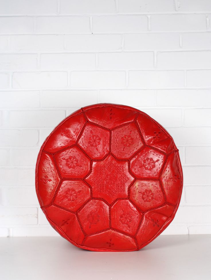 Moroccan leather pouffe in Red, made by hand featuring an intricate tile embroidered design.  Approx size: Diameter 53cm x Height 28 cm.  Available from www.bohemianliving.com.au