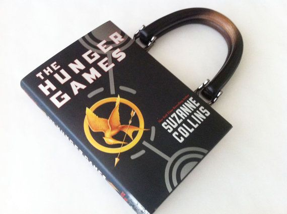 What better way to combine two of the greatest things ever (handbags and books, of course!) than a Hunger Games purse?    The dimensions are 8.5x 5.5 x 2″. This book handbag is created with a pocket meant for credit cards and closed with a simple button. A great gift for any book lover you know!