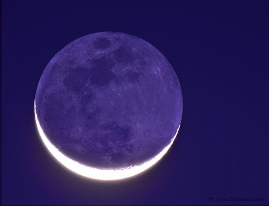 New Moon in Old Moon's Arms.  Image Credit & Copyright: M. Taha Ghouchkanlu  Explanation: The Moon's ashen glow, or Earthshine, is earthlight illuminating the Moon's night side. Taken on March 20 2012 (equinox) from Iran. The darker earthlit disk is in the arms of a bright sunlit crescent. A description of Earthshine, in terms of sunlight reflected by Earth's oceans in turn illuminating the Moon's dark surface, was written 500 years ago by Leonardo da Vinci.