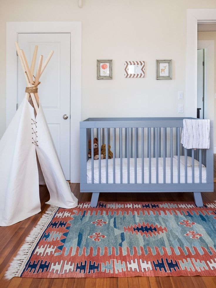 A tipi, Mexican rug, and bright crib add fun touches to this nursery. Amy & Peter's Minimalist Home with Latin American Roots