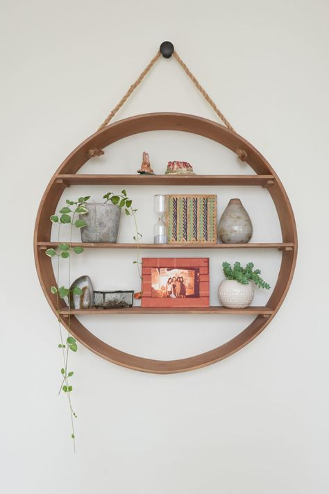 I bought this today.. It's huge! ...gonna paint it gray and distress it.  And metal leaf the edges. rose gold.  Round Wall Shelf | World Market