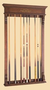 Antique Brunswick pool cue rack from the late 1800's. Available at Peters Billiards in Minneapolis, MN.