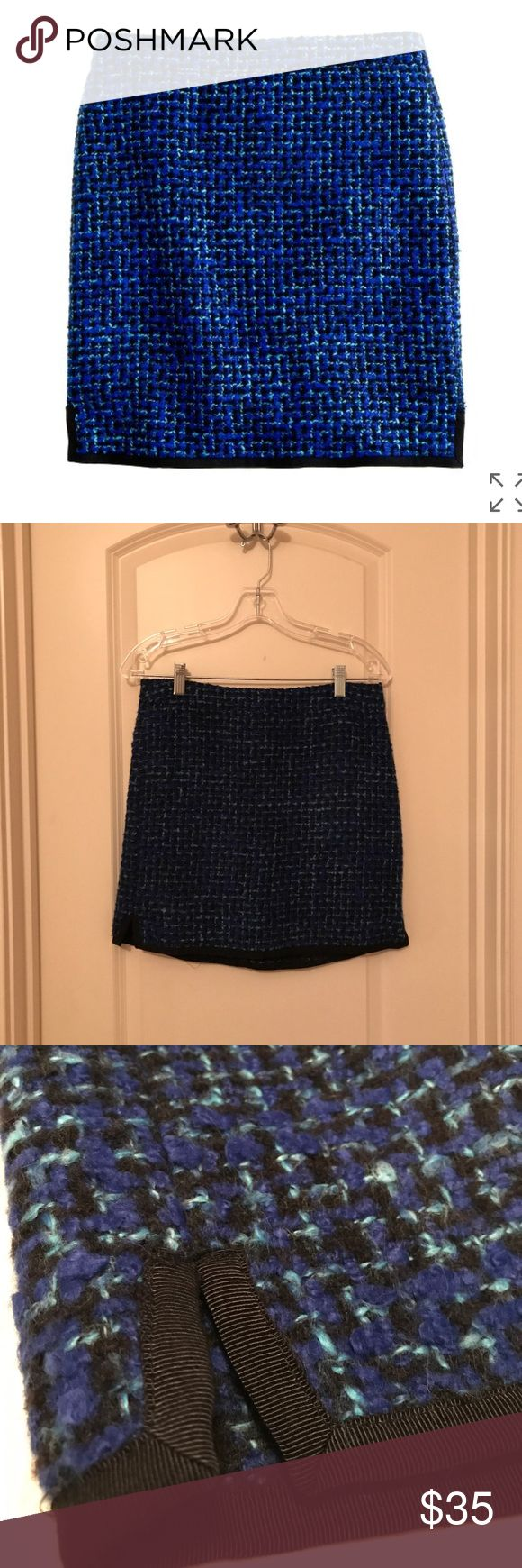 J.Crew Postage Stamp Mini in Indigo Tweet - Size 2 Crafted in a subtle A-line shape to hang off the hip, it's absolutely of the moment in an indigo tweed that will make your entire wardrobe pop. - Acrylic/poly/wool/cotton - Sits above the waist - Back Zip - Lined J. Crew Skirts Mini