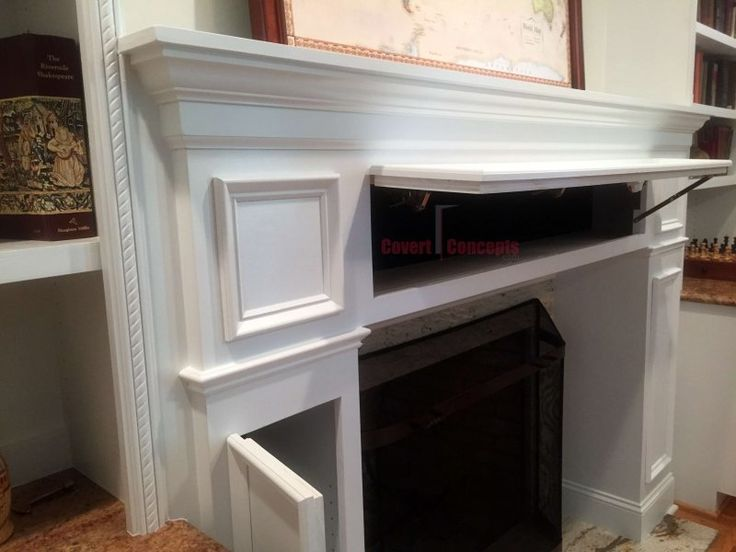 turn your fireplace or media built in shelving into hidden storage with Covert Concepts products of custom secret doors and stealth wall concealed storage