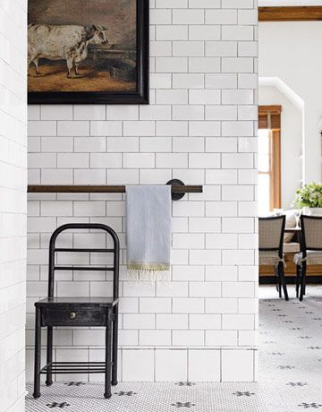 Schindler kept continuity with the kitchen by extending the black-and-white tile through the pantry into the room.