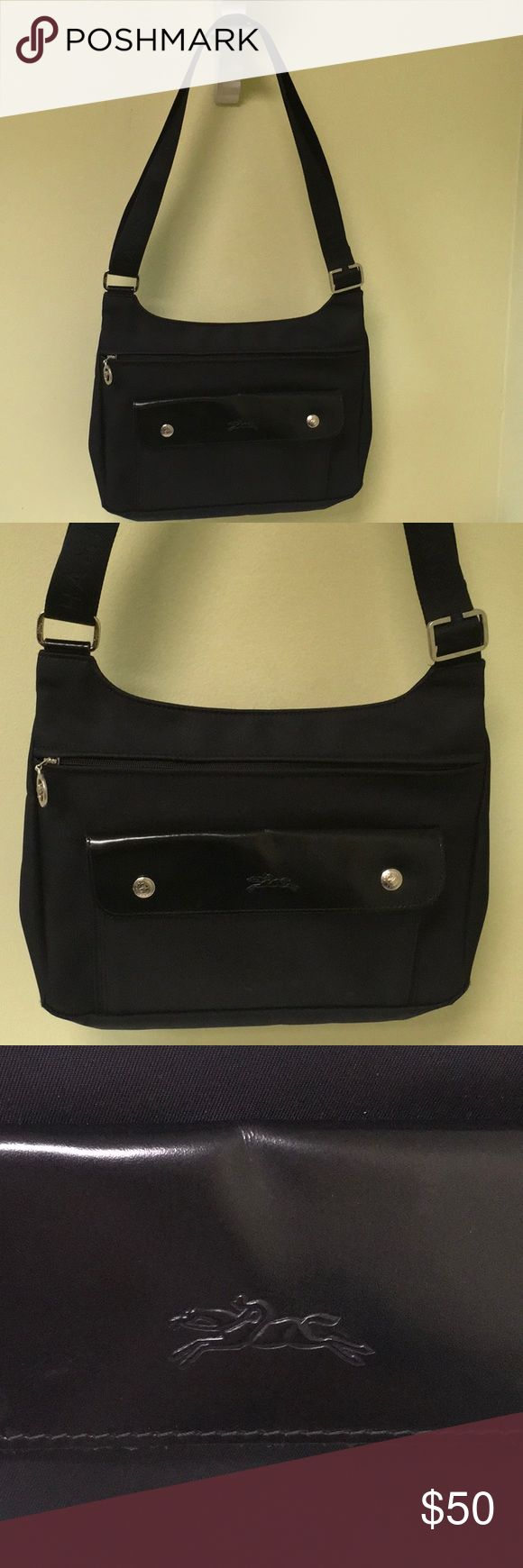 """Longchamp Planetes Black Nylon Cross Body Bag Up for sale is a preowned Longchamp Planetes Black Nylon Cross Body Bag in very good condition with no major wear and only showing minor signs of prior use.  The Nylon has a couple marks that are probably easily cleanable.  This bag is in great shape with. Lot of life to be had. It measures 12"""" W x 9"""" H x 2 1/2"""" W. the strap is adjustable for shoulder wear or cross body wear. Authentic guaranteed Longchamp Bags Crossbody Bags"""