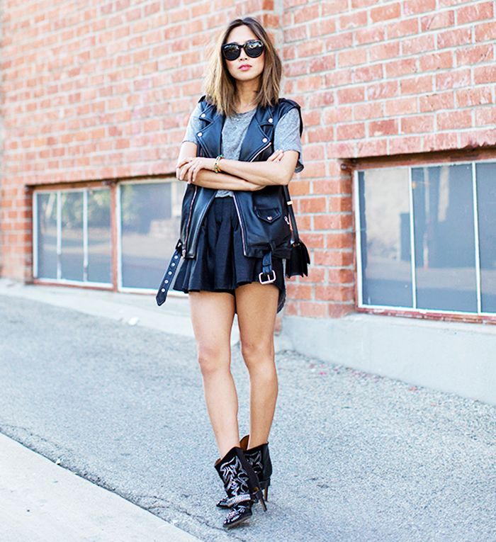 Aimee Song of Song of Style in a moto vest, grey t-shirt, mini skirt, and booties