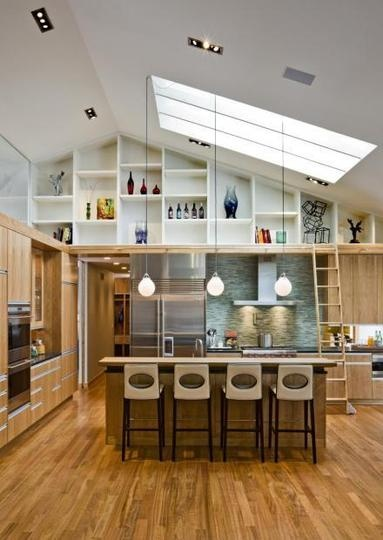Love the height, the light, and the layout! Also the idea of a library being integrated with that display shelving.