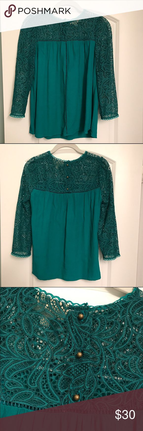 Turquoise Lace 3/4 Sleeve Shirt Beautiful turquoise shirt. 3/4 lace sleeves. Stitching down the front is see-through. Gold button closure on back. 53% viscose, 47% rayon. Anthropologie Tops Blouses