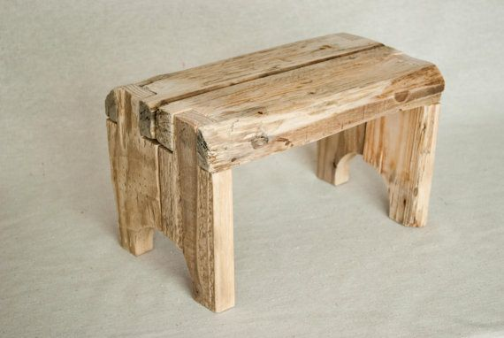 a rustic step stool made entirely out of reclaimed wood.