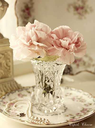crystal vase on antique plate....add flowers and put at bedside...