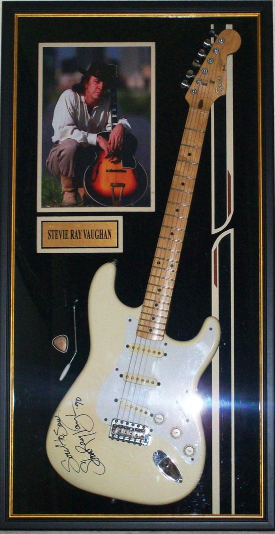 """Stevie Ray Vaughan Memorabilia Showcase ... Featuring Stevie's famous Fender Squier 'Double Trouble"""" Guitar                                            •Autographed inscription """"Soul to Soul - '90"""""""