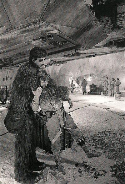Peter Mayhew and Mark Hamill hugging on the set of The Empire Strikes Back.