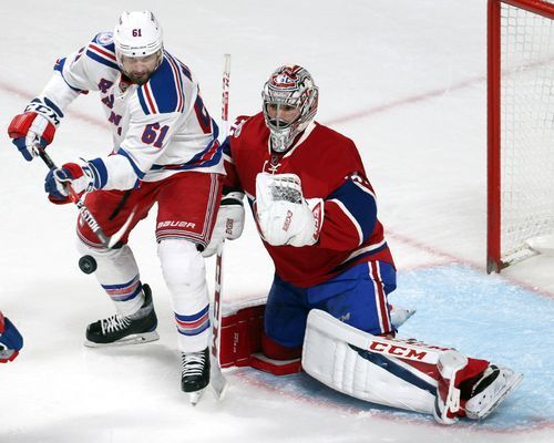 Rangers winger Rick Nash and Canadiens goalie Carey Price go for the puck in Game 1.(Photo: Jean-Yves Ahern, USA TODAY Sports)     The march to the Stanley Cup begins with best-of-seven matchups in the first round. Here's the full schedule so you can keep up with the all the action...  http://usa.swengen.com/2017-nhl-stanley-cup-playoffs-first-round-schedule-scores/