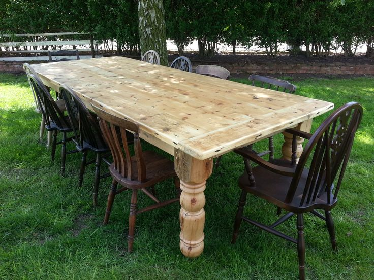 Antique odd chairs around reclaimed pine Victorian style table with breadboard ends.