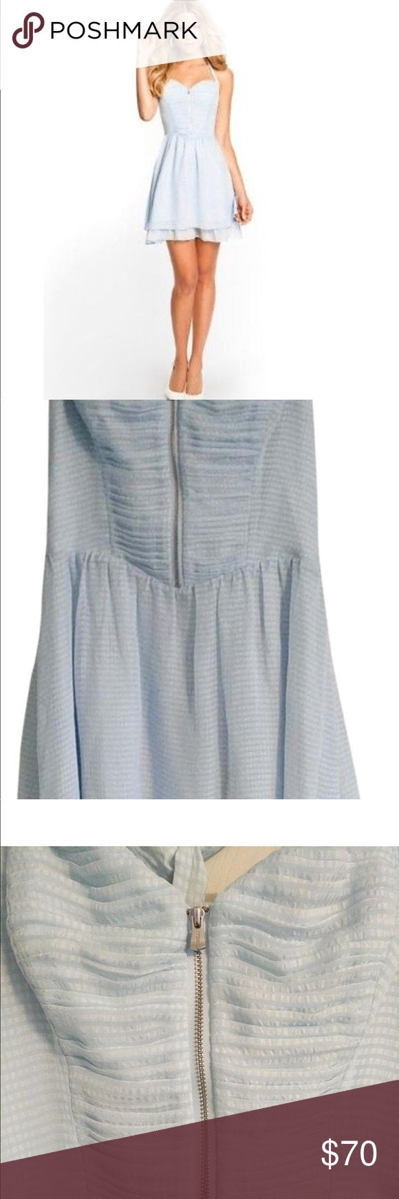 Guess mirage Ingrid dress Brand new with tags. Checked pastel blue pattern. Sweetheart neckline. Halter straps tie at neck. For and flare style. Exposed front zipper. Peek-a-boo ruffles hem. Size 4. Guess Dresses Mini