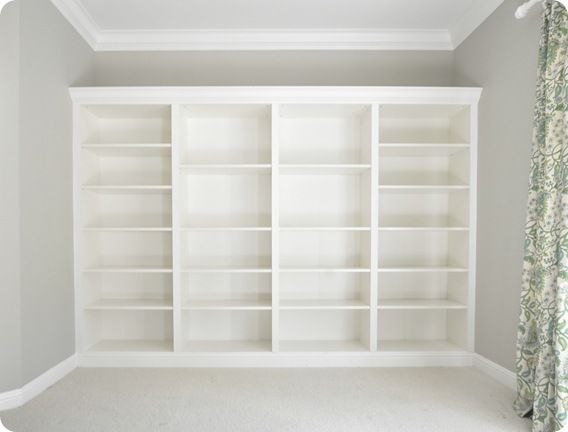 "Cost: four 15"" deep Billy bookcases at $69 each ($300 with tax), plus plywood, crown molding and trim: $65"