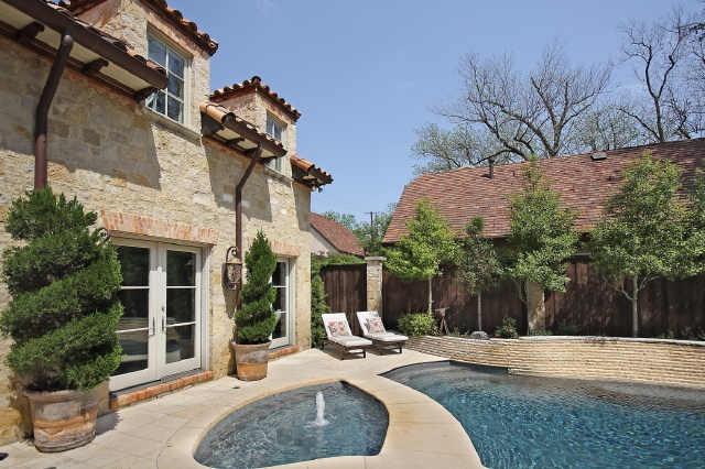 Stone/brick vs. stucco exterior on a Mediterranean style home.