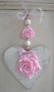 White wooden heart with pink soap roses.