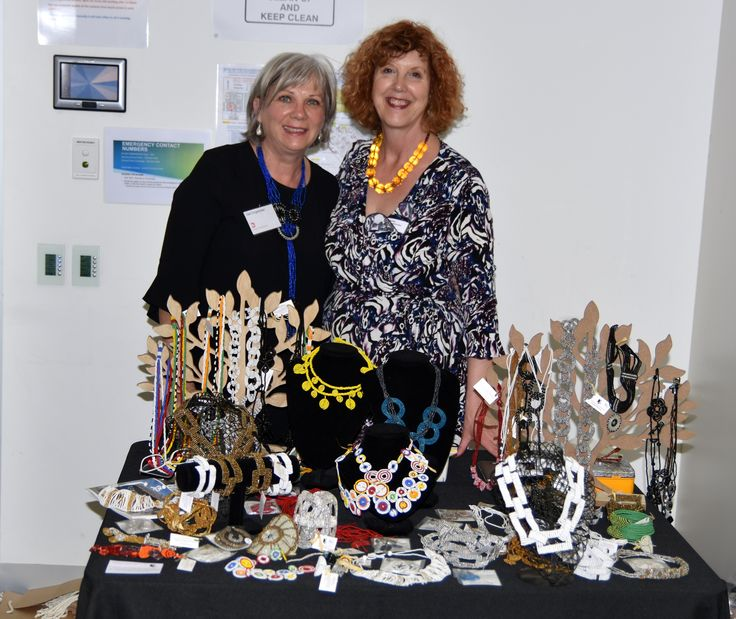 Kathy and Gail Drogemuller showcasing jewellery from Africa.