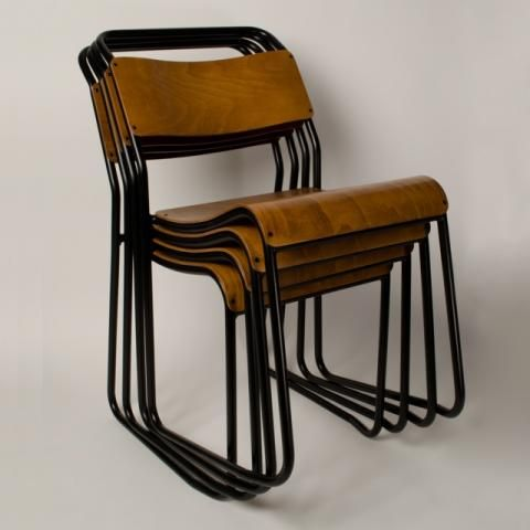 The Trainspotters stacking chair. This is the new and improved re-make of this design classic. Originally produced in Britain from the 1930's-1960s, the tubular steel and plywood stacking chair was utilised extensively in hospitals, schools and village halls throughout the land.