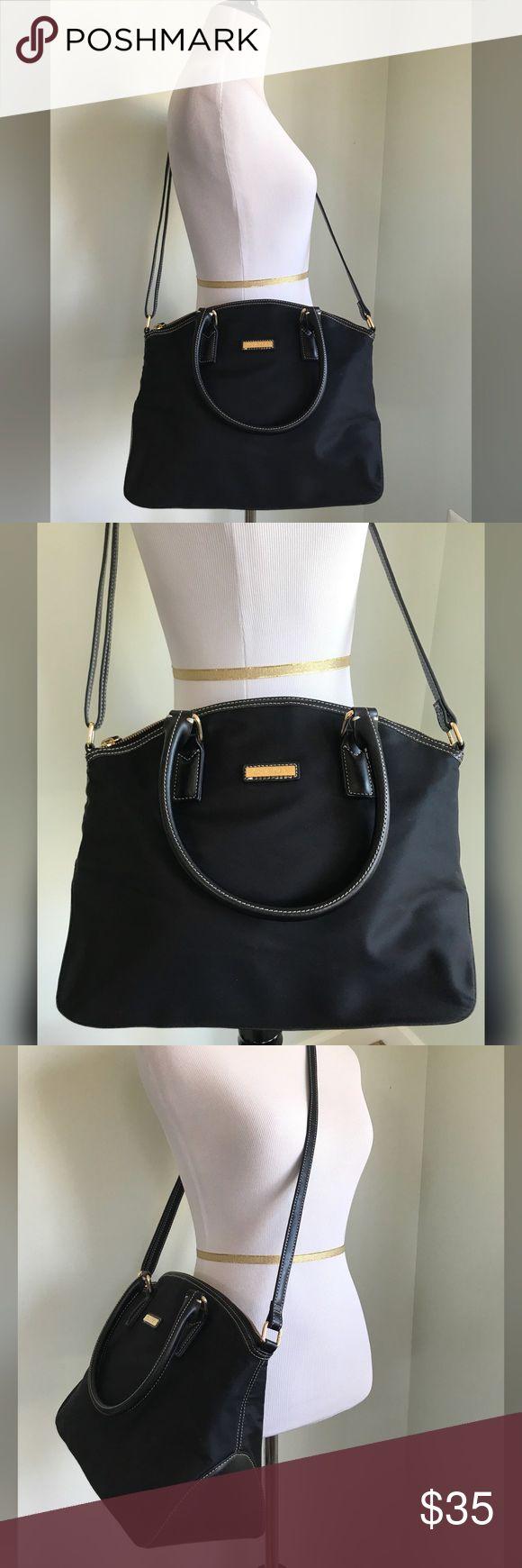 "Calvin Klein Black Crossbody Black crossbody from Calvin Klein.  Gold hardware.  Nylon material.  Black inside fabric with logo.  Inside pockets. EUC. Only wore a couple of times. 18"" strap Length.  10"" height. 5 1/2"" Deep.  13"" Width.  Top zipper. Calvin Klein Bags Crossbody Bags"