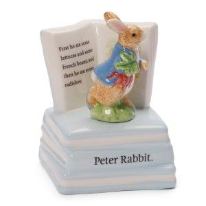 """Gund Classic Beatrix Potter Peter Rabbit Musical Sculpture This ceramic musical sculpture winds up to play """"rock-a-bye baby"""" while a detailed peter rabbit figurine rotates on top of a stack of books."""