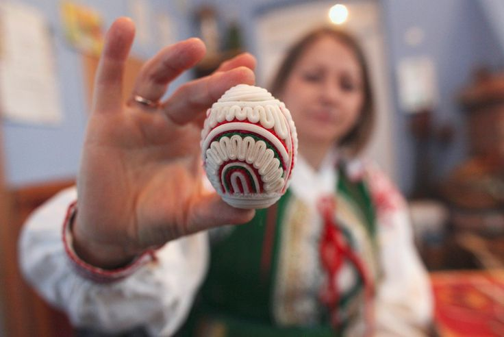 Artist Olga Dawidczyk shows a traditionally decorated Easter egg at Kuznia Kurpiowska, a museum in the ethnic region of Kurpie in Pniewo, Poland on April 4, 2012. In Kurpie, traditional Easter eggs are decorated with white bulrush pith and colored wool.