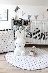 Monochrome baby play mat and pof. Arrows crib organizer. All items available at nukkodesign.com