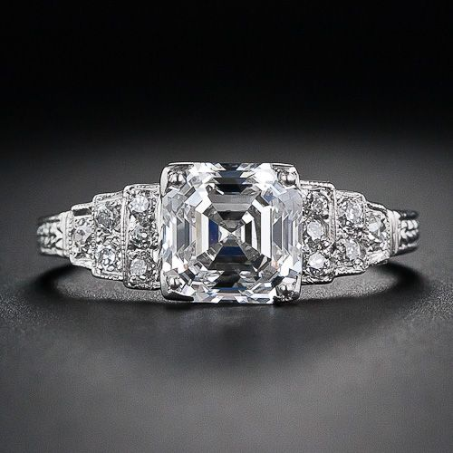 2.03 Carat 'F-VS1' Asscher Cut Diamond Engagement Ring. Platinum diamond-studded stairsteps lead up to a beautiful, bright-white, high-quality Asscher-cut diamond set in classic geometric Art Deco style. A radiant and sophisticated engagement ring in timeless 1920s vintage style.