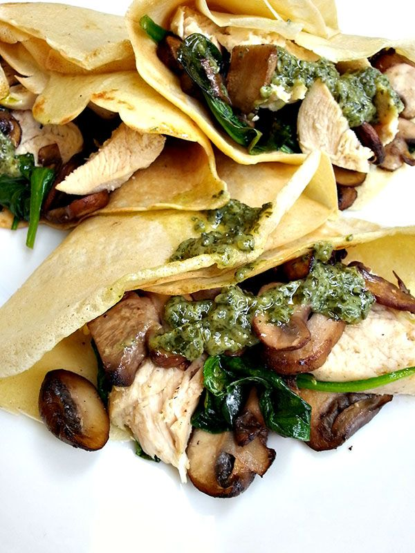 Savory crepes stuffed with roasted chicken, mushrooms, spinach and pesto!