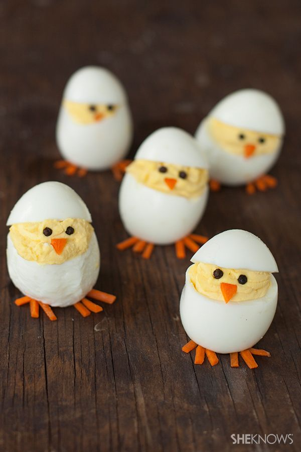 Cute Hatching Baby Chicks deviled eggs - peppercorns for eyes, carrots for feet and nose
