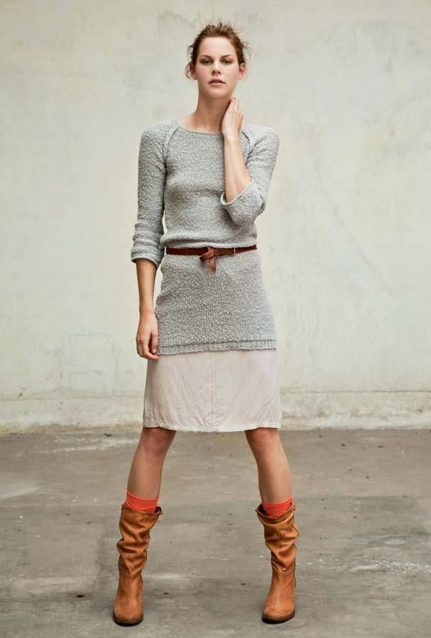 Super simple, but it works: A long sweater over a knee-length skirt + boots and a belt.