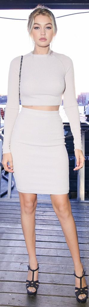 '90s throwback style inspiration: Gigi Hadid wearing a crop top and skirt matching set