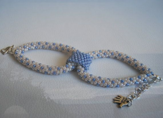 English: The bracelet is made Kumihimo technique and the connector peyote…